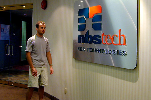 nbstech office lobby metal finish sign made with large brushed acrylic background and push through lettering