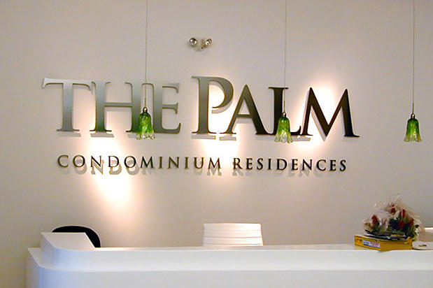 The Palm corporate condo sales office lobby signage made with 3d metal sign lettering installed in reception area and made by Art Signs