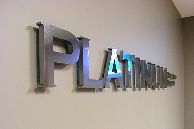 3d dimensional corporate office lobby reception signage and logo sign lettering raised off the reception area wall on spacers