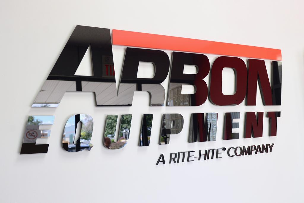 Black plastic lettering with custom red details as new Corporate Signage for Arbon Equipment